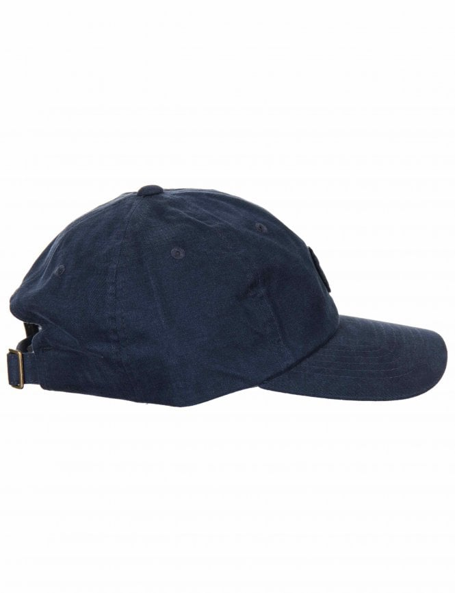 Brixton Wheeler Strapback Cap - Navy - Accessories from Fat Buddha ... 66d2114b45d