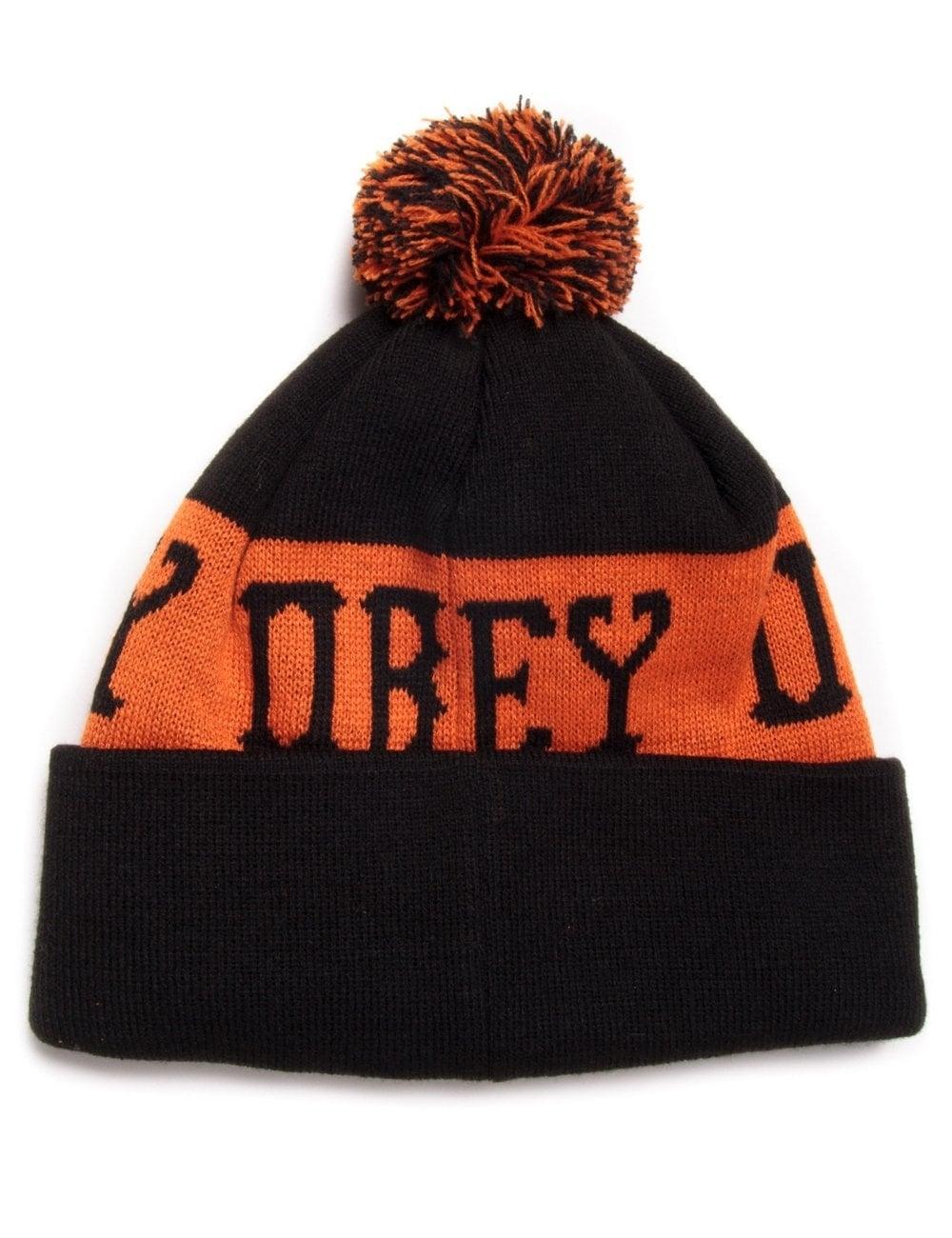 3ccb7a418 Crowned Pom Pom Beanie - Black/Orange